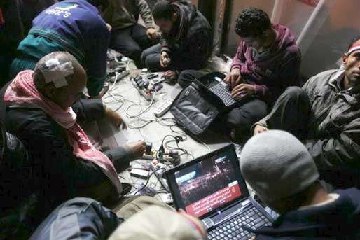 Bloggers in Tahrir Square work on the internet to coordinate protests in Egypt via Facebook and Twitter and to contact media outlets across the globe.